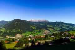 Beautiful alpine summer landscape. Mountains and sun, blue sky, Stock Photos