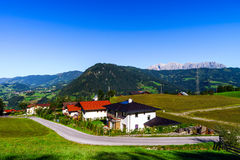 Beautiful alpine summer landscape. Mountains and sun, blue sky, Royalty Free Stock Photography