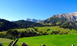 Beautiful alpine summer landscape. Mountains and sun, blue sky, Stock Image