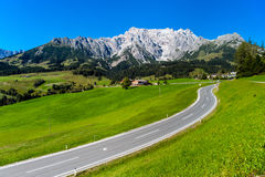 Beautiful alpine summer landscape. Mountains and sun, blue sky, Royalty Free Stock Image