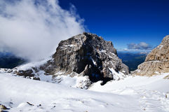 Beautiful alpine view. Alpine landscape with peaks, clouds and snow near San Martino di Castrozza, Italy Stock Photo