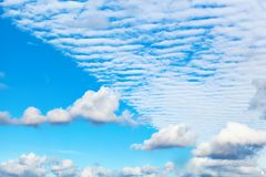 Beautiful Altocumulus and Cumulus clouds. In the center a spect Stock Images
