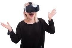 Beautiful amazed woman experiencing virtual reality Stock Photo