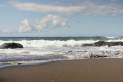 Beautiful amazing beach of Ribeira Grande in Sao Miguel island in Azores Portugal with wild sea waves Stock Photos