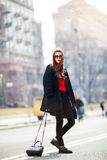 Beautiful amazing brunette woman with long wavy hairstyle in spring or fall stylish urban outfit walking on the street. Street fas Stock Photo