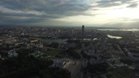 Beautiful and amazing view over the town. You can see the streets, the houses, the big skyscraper, the sun`s rays burst stock video footage