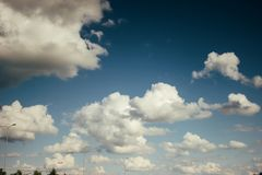 Beautiful amazing view of sky and clouds on highway road near ai Royalty Free Stock Image