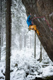 Beautiful amazing winter mountains. A man goes a sport climbing in snow holidays. Christmas background. Unique landscape. Northern stock photography