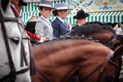 Beautiful amazons in traditional dress riding at the April Fair Seville Stock Images
