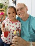 Beautiful Amerasian girl with her Grandpa Stock Image
