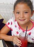 Beautiful Amerasian girl with pink lemonade stock images