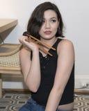Beautiful Amerasian 19 year old girl with beginner chopsticks Royalty Free Stock Image