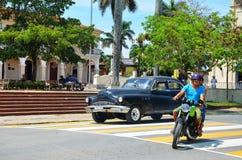 Beautiful american cars and life in Cuba Stock Photos