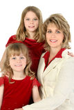 Beautiful American Family. Smiling portrait of a mother and her daughters Royalty Free Stock Photography