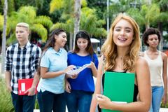Beautiful american female student with group of international pe stock image