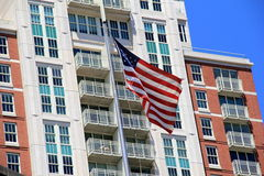 Beautiful American flag in front of modern apartment building Royalty Free Stock Image