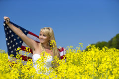 A beautiful with american flag in yellow field Royalty Free Stock Photos