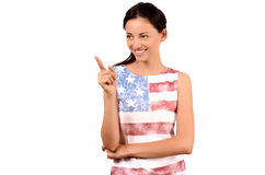 Beautiful American girl pointing to the side. Royalty Free Stock Photo