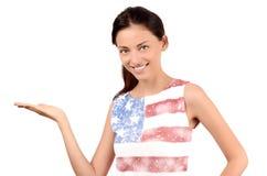 Beautiful American girl presenting. Stock Photo