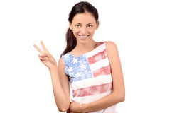 Beautiful American girl signing victory. Royalty Free Stock Photo