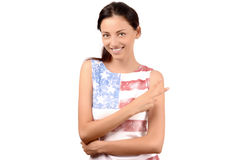 Beautiful American girl signing victory. Attractive girl with USA flag on her blouse. Isolated on white Stock Photos