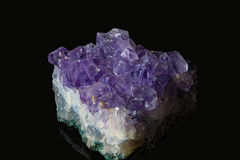 Beautiful amethyst druse close-up. On black background Stock Photo