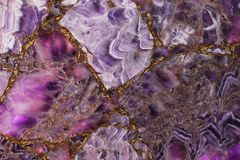 Beautiful amethyst purple backlit, the light highlights how translucent parts of the stone and it becomes pink. Beautiful texture royalty free stock images