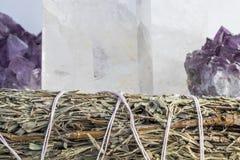 Beautiful Amethyst, Quartz Crystal and a Sage Bundle Close Up stock photos