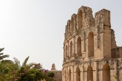 The beautiful amphitheatre at El Jem and the minaret, Tunisia, Africa stock photos