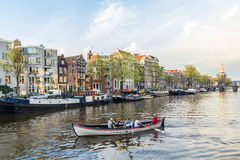 Beautiful Amsterdam canal scene. Amsterdam , the Netherlands - April 13, 2016: beautiful Amsterdam canal scene royalty free stock photography