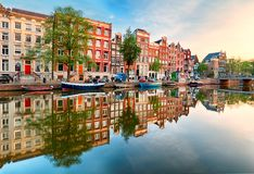 Free Beautiful Amsterdam Sunset. Typical Old Dutch Houses On The Bridge And Canals In Spring, Netherlands Royalty Free Stock Photo - 142917965