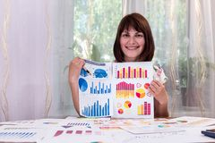 Beautiful analyst with business graphs. In office stock photos
