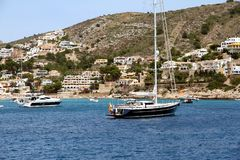 Touristic coast of Moraira with all type of Yachts and sailboats. Royalty Free Stock Images