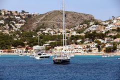 Touristic coast of Moraira with all type of Yachts and sailboats. Beautiful anchorage and sailing zone in the north coast of Alicante in Spain close to Moraira Royalty Free Stock Photo