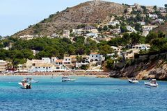 Touristic coast of Moraira with all type of Yachts and sailboats. Beautiful anchorage and sailing zone in the north coast of Alicante in Spain close to Moraira Royalty Free Stock Image