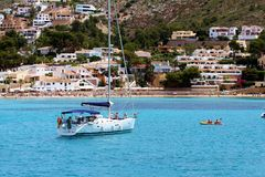 Touristic coast of Moraira with all type of Yachts and sailboats. Stock Images