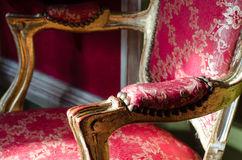 Beautiful ancient antique chair in red and white colors Stock Images