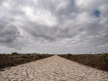 Road to the Lighthouse in Fortaleza de Sagres, Portugal, Europe on a cliff. royalty free stock photo