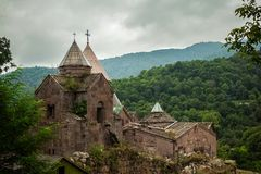 Armenian monastery between the mountains in Armenia royalty free stock photo