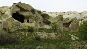 Beautiful Ancient Cave Houses in Remote Area of Cappadocia`s Landscape. Beautiful ancient cave houses in a remote area of Cappadocia. / Cappadocia is a Stock Photo