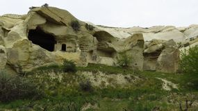 Beautiful Ancient Cave Houses in Remote Area of Cappadocia`s Landscape. Beautiful ancient cave houses in a remote area of Cappadocia. / Cappadocia is a Royalty Free Stock Photo