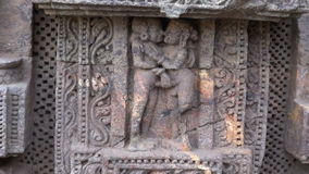 Beautiful ancient erotic sacred art sculptures on Konark temple, India stock video