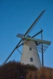 Beautiful ancient flemish windmill. Beautiful ancient white flemish windmill in the blue sky Royalty Free Stock Images