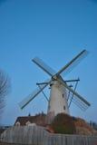 Beautiful ancient flemish windmill. Beautiful ancient white flemish windmill in the blue sky Royalty Free Stock Photos