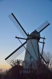 Beautiful ancient flemish windmill. Beautiful ancient white flemish windmill in the blue sky Stock Photography