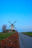 Beautiful ancient flemish windmill. Beautiful ancient white flemish windmill in the blue sky Stock Photo