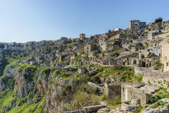 Beautiful ancient ghost town of Matera Sassi di Matera in beau. Tiful bright sun shine with blue sky, south Italy Stock Images
