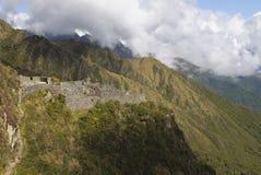 Ancient Inca ruin of Sayaqmarka watching over an andes valley. Hiking the inca trail past several beautiful Inca ruins, like Sayaqmarka royalty free stock images