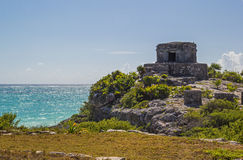 Beautiful ancient temple and sea  in archaeological zone Tulum,. Picturesque view of ancient temple on the rock and the Caribbean sea Stock Images