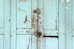 Beautiful ancient wooden door with metal lock texture background Royalty Free Stock Images